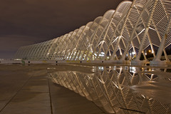 Calatrava - Olympic Agora: rain reflection (* K a t e r i n a) Tags: nightphotography reflection rain architecture pond geometry stadium curves athens greece calatrava olympic agora santiagocalatrava  olympicagora geometriegeometry