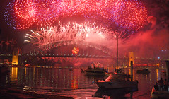 Happy New Year - Sydney 2011 (Dawn Woodhouse) Tags: pink light red rot water rouge boat rojo fireworks harbour sydney australia sparkle newyearseve joyful rood rosso ahmar sydneyharbour 2010 mcmahonspoint wow1 photohobby greatphotographers kokino crven flickraward aplaceforgreatphotographers