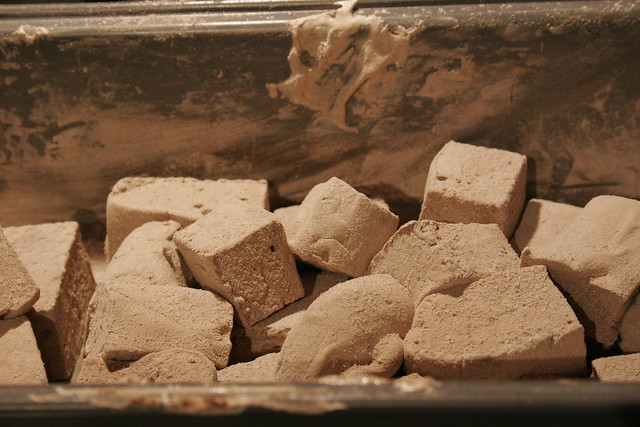homemade cocoa marshmallows in a messy pan