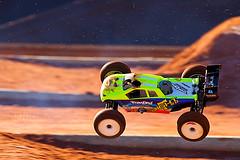 Madman behind the wheel! (HisPhotographs.com) Tags: motion speed ga flying bokeh tires dirt midair savannah panning flyingcar sav rccar shallowdof neoncolors georgiaredclay canonlseries