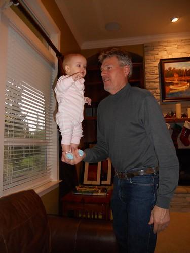Baby balancing in Papa's hands