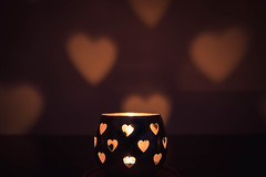 Burning Desire (NVOXVII) Tags: candle candlelit hearts love arty lowlight night ambient mellow autumn cosy nikon cute bokeh tones tealight depthoffield dof stilllife