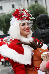Beautiful Ms. Claus (shaire productions) Tags: sf sanfrancisco santa christmas street xmas city winter red people holiday streets fall smile hat goofy smiling festive season reindeer fun photography photo costume outfit funny colorful december santas candid seasonal culture dressup celebration suit event photograph gathering theme santaclaus santacon annual jolly claus activity kriskringle fest cultural flashmob 2010 hohoho santarchy yearly santaconsf sfsantacon sanfranciscosantacon