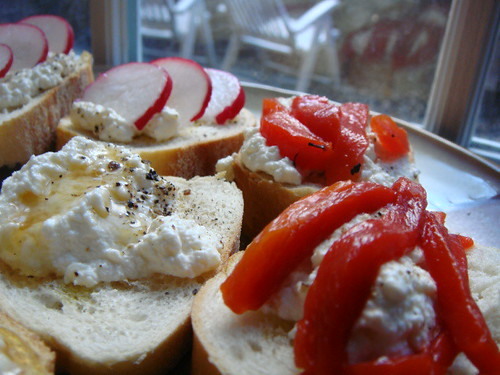 Crostini with homemade ricotta, three ways. Honey, radish, roasted red pepper.