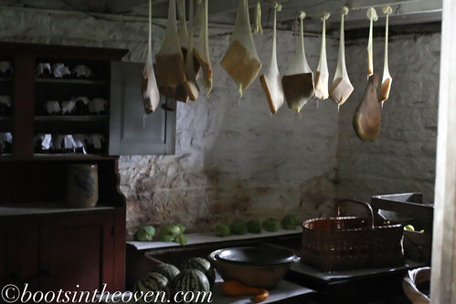 Cheeses and meats hung to dry and cure in the 19th-century farmhouse