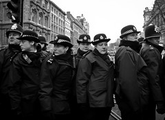(Sven Loach) Tags: uk blackandwhite westminster canon riot britain budget protest police cameron government coalition met whitehall cuts coppers 2010 conservatives fees demos tuition tories g11 liberaldemocrats clegg studentprotests metropolitanpolice