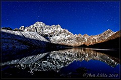 Moon rise (NeilsPhotography) Tags: travel blue nepal moon snow color colour reflection slr wow landscape mirror interestingness amazing interesting asia great explore moonrise mountian 2010 outstanding lr3 npl 550d cs5 canon550d neilliddle lnak mountianwhite landseavision liddlephotography