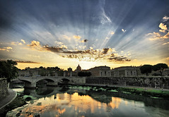 Glorious Sunset in Rome (` Toshio ') Tags: city bridge blue trees sunset italy vatican stpeters rome roma reflection history yellow wall clouds buildings golden ancient ruins europe italia european cityscape cloudy path basilica bank glorious tiber historical rays hdr highdynamicrange embankment europeanunion romans ceasar stpetersbasilica godrays toshio tiberriver platinumheartaward