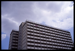 Just another day (gullevek) Tags: sky building film japan clouds iso100 tokyo kodak laundry      housebuilding  kodakektachromee100vs  fujigw690iii ebcfujinon90mmf35