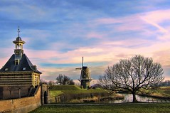 behind the water gate - a closer side view (Wim Koopman) Tags: sky holland tree water netherlands windmill dutch photography photo gate colorful path stock footpath watergate stockphoto kleurrijk stockphotography gorinchem gorkum wpk