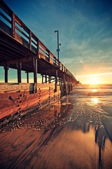 sunset perspective (Eric 5D Mark III) Tags: california light sunset sky usa cloud seascape color reflection beach water canon landscape pier sand exposure unitedstates perspective atmosphere wideangle newportbeach sunburst orangecounty tone ef14mmf28liiusm eos5dmarkii