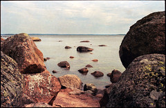 Rocky landscape (Juha Helosuo) Tags: sea summer color film nature water beautiful rock analog 35mm canon suomi finland landscape island photography 50mm midsummer 14 grain rocky 135 dust maisema juhannus ftb kes kotka kaunissaari