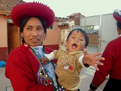 Chinchero woman in traditional dress (laura2611) Tags: street red house peru hat cuzco america clothing child dress cusco south traditional bead weaving chinchero