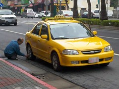 Taxi Driver Cleaning His Cab