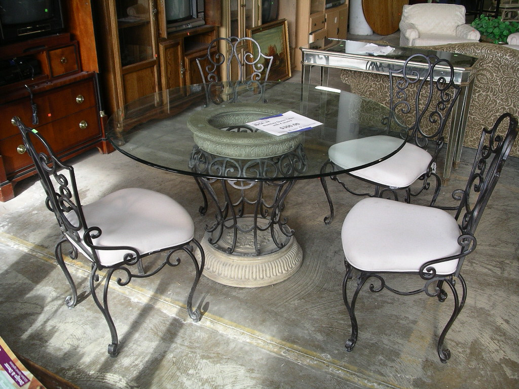 "54"" Round Glass Top Table and Chairs  $300"