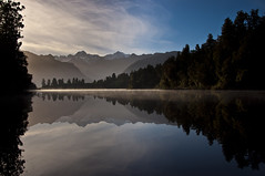 Lake Matheson (Explored) (~Urban Prowler~ (www.anshumm.com)) Tags: newzealand mist ice reflections snowcapped foxglacier southisland peaks tasman lakematheson mountcook nikond90 18105vr anshummandore anshumm urbanprowler