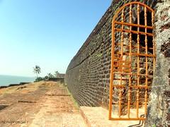 The gate to  bekal beach .. Pics from Bekal Fort (brainseizer2) Tags: sea india beach yellow poster gate vishnu you fort wide score cochin distant kannur bekal kanhangad kerele
