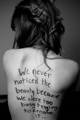 We Never Noticed the Beauty (wakeupbaylee) Tags: flower girl tattoo writing back twilight nikon text font d200 curlyhair kass matta kassidi photowithtext textonphoto wakeupbaylee