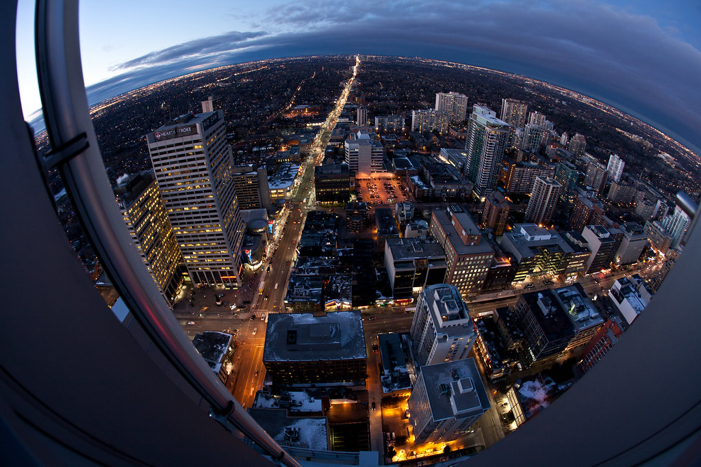 fisheye image of the city of toronto skyline, looking north from yonge and eglinton