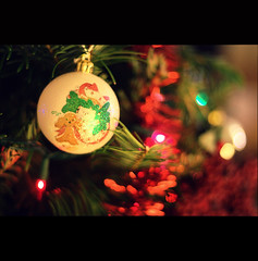 Christmas is here, bringing good cheer.. (Mya and the Glittering Withywindle) Tags: christmas xmas winter red party white holiday tree green canon festive rebel 50mm december bokeh object indian decoration christmastree celebration ornaments gift portlandoregon christmastime xsi 450d myaphotography