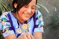 Laughing Tz'utuhil Maya Girl with traje, huipi...