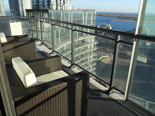 Outdoor wicker patio furniture on condo balcony in Toronto