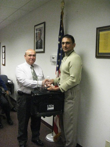 Dr. Jaroslaw Fabis (left) shakes hands with Albany District Manager Haroon Mian for his efforts while working on a USDA assignment with the Provincial Reconstruction Team in Iraq. Photo contributed by Linda Kane, OFO.