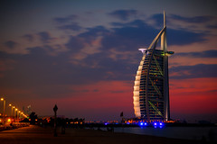 Burj al-Arab lit (modenadude) Tags: ocean city pink blue sky orange 3 building tower love beach beautiful beauty architecture night clouds photoshop canon dark is persian sand dubai open gulf dusk gorgeous muslim islam famous tripod uae icon adobe shutter sail usm vignette luxury f28 unitedarabemirates hdr burj retractable lightroom alarab 1755 emirati photomatix 550d cs5 t2i