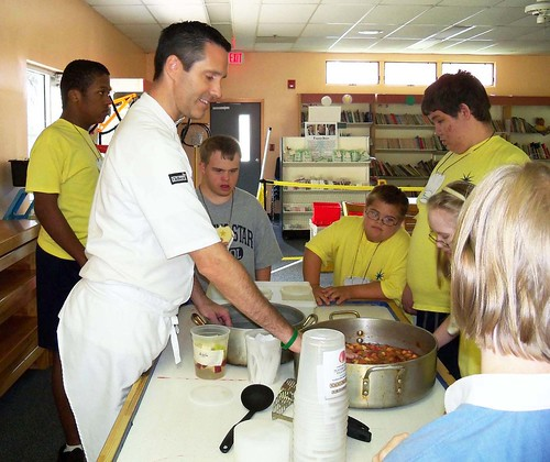 Chef Jamie McFadden and Special Needs students at Morning Star School in Orlando, Fla., make fresh apple sauce as part of the Chefs Move to School initiative.