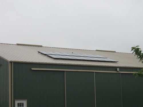 2-Solar panels augment the power generated by the wind turbine, reducing the cost of power purchases for the stables.
