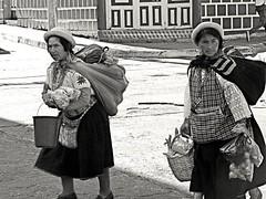 Working (halifaxlight (back in March)) Tags: street bucket ecuador women basket hats sunny laden banos camerabag carrying sellers vendors flickraward