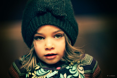 Kind words can be short and easy to speak, but their echoes are endless. (Rebecca812) Tags: family portrait brown girl hat childhood horizontal child daughter knit bow hazeleyes snowpants warmclothing canon5dmarkii familygetty2010 rebecca812