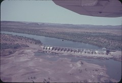 1963-circa Ord River Diversion Dam near Completion - KHS-2010-2-156-er-PD (Kununurra Historical Society Archive & Museum) Tags: dam ord survey irrigation surveyor pwd 1963 ion surveying kununurra ordriver westernaustraliaaustralia publicworksdepartment bandicootbar ordriverirrigationarea cyrilion engineeringsurveyor khs20102156eypd 1963ordriverdiversiondamaerialview