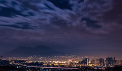 """E 'o viento port' zolfo e aroma, 'o golfo ispir 'o poema e 'na sirena, protagonista 'e st'odissea"" (LuxTDG) Tags: lafamiglia odissea napoli naples vesuvio vesuvius panorama landscape seascape ora blu blue hour citt city cityscape palazzi case palaces homes house scie luminose automobili car light trails luci lights notte night freddo cold cielo sky nuvole clouds vento wind ponte bridge centro direzionale directional center golfo bay gulf campania lunga esposizione long exposition mare sea albero tree inverno winter italy italia natale christmas"