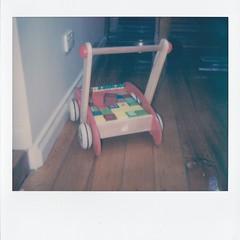 Baby walker, building blocks (Matthew Paul Argall) Tags: polaroidspectra impossibleproject walker pushcart 2016 buildingblocks woodenfloor powerpoint