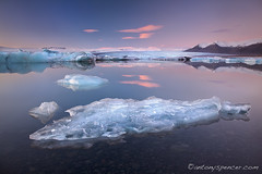 Jkulsrln Twilight (antonyspencer) Tags: winter sunset ice reflections landscape frozen iceland twilight lagoon calm glacier iceberg icebergs jokulsarlon glacial