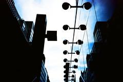 A row of lamps (Markus Moning) Tags: new york city nyc sky usa ny reflection film lamp facade 35mm us lomo lca xpro lomography cross united himmel ct row x pro 100 states lamps process lc agfa processed fassade reflektion lampen moning precisa markusmoning