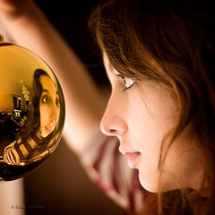 the christmas spirit (helen sotiriadis) Tags: christmas portrait reflection face canon ball gold published dof bokeh profile depthoffield projection ornament escher nix spherical canonef50mmf14usm canoneos40d