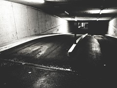 Deep-Level Tar Garage (Yves Roy) Tags: street nightphotography blackandwhite bw night dark blackwhite europe raw streetphotography eu fav20 gr bandw ricoh yr darknight darknights fav10 therogue blackwhitephotos grdiii ricohgriii ricohgr3 ricohgrdiii yvesroy darkstreetphotography
