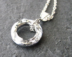 jewelry 128 (SerendipitybyErin) Tags: california necklace jewelry elegant brentwood pendant swarovskicrystal sterlingsilver bloomingflower diamondshape cosmiccircle erindavenport serendipitybyerin