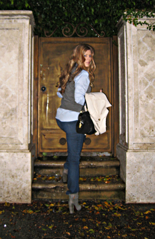 jeans+button down+sweater vest+burberry trench+gray boots+curled hair+doorstep+rain