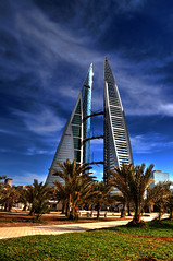 Bahrain Trade Center ( Hussain Frutan | www.hf-photos.net) Tags: blue sun green grass night speed lens landscape photography bahrain high nikon view shot photos d blues center micro land 5000 18 55 scape trade sunbeam plam vr manama arad bahrian hussain hf  fozool cloued  muharaq d5000  maharaq cloueded frutan wwwhfphotoscom