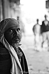 The old man [EXPLORE] Dec 25 2010 (Mayank Sharma renewed :D :D) Tags: morning portrait bw canon 50mm focus bokeh streetphotography oldman photowalk chandnichowk canon50mm