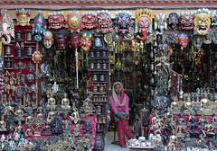 For Sale (cormend) Tags: city travel nepal woman shop canon d50 eos asia mask bored tourist souvenir masks kathmandu swayambunath trap trinkets monkeytemple cormend