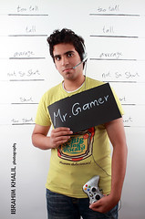 Mr.Gamer (Ibrahim Khalil) Tags: blue our friends boy shadow portrait people orange brown black color guy green colors look canon dark fun photography big friend dubai alone brother photographers busy experience 7d saudi arabia arabian ibrahim cuz lovly  lonlyness dammam exposior  colorphotoaward pohtographer ibrahimkhalil  alestudio