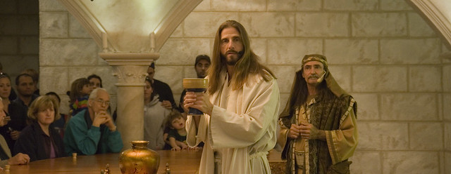 Jesus is holding the cup