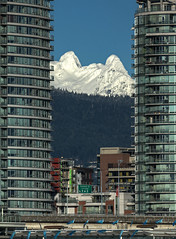 The Lions Framed (gordeau) Tags: snow mountains vancouver buildings framed gordon lions ashby flickrchallengegroup flickrchallengewinner thechallengefactory gordeau