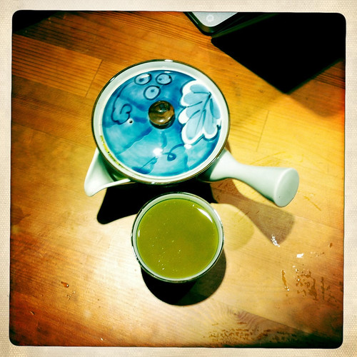 Making green tea in a blue pot