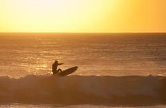 surfing in Canary Islands (- GD photography -) Tags: sunset sea sun sol beach grancanaria atardecer mar agua nikon wave playa canarias surfing lugares silueta olas canaryislands islas camaras islascanarias maspalomas surferos 2011 meloneras d90 municipios sanbartolomedetirajana