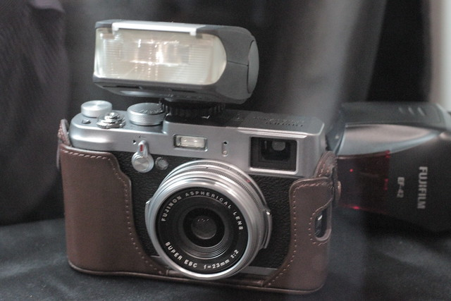 Fujifilm X100 in case with flash